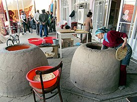 Baking Bread in Bai Bazaar, Dashoguz.jpg