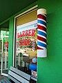 Barber shop with painted barber pole, Lake Placid, Florida.jpg