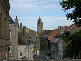 A street and the belfry of Bergues