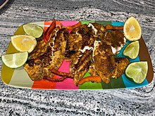 Blackened tilapia with Cajun spices, lemon and lime juice
