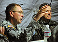 Brazilian military Gen. Floriano Peixoto, commander of United Nations Stabilization Mission in Haiti, listens to U.S. Army Lt. Gen. P.K. Keen, deputy commander of U.S. Southern Command and commanding general of 100311-N-HX866-009.jpg