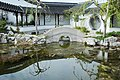 Bridge reflecting in lake inside Dunedin Chinese Garden.jpg