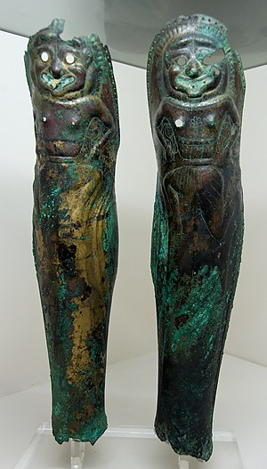 Pair of greaves with a Gorgon's head in relief...