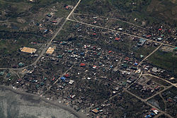 Buildings and roads in the Philippine town of Maconacon are visible from a P-3C Orion aircraft carrying U.S. Sailors Oct. 22, 2010 101022-M-ZA787-051.jpg