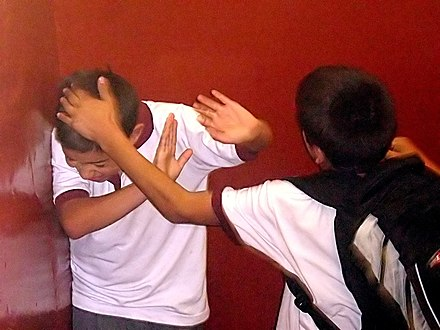 Bullying, one form of which is depicted in this staged photograph, is detrimental to students' well-being and development. Bullying on Instituto Regional Federico Errazuriz (IRFE) in March 5, 2007.jpg