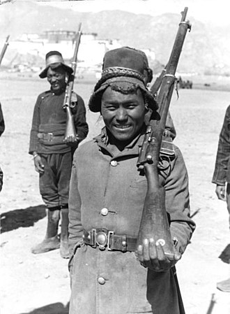 Tibetan Army - Tibetan soldier with a Lee–Enfield rifle in 1938