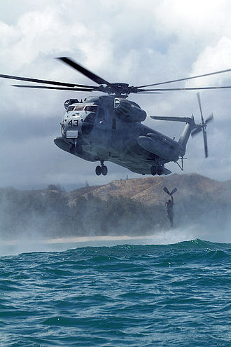 Helocast - A United States Marine jumping from a CH-53D Sea Stallion during a helocast off the coast of Hawaii.
