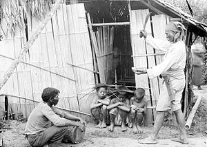 Shamanism - South Moluccan Shaman exorcising evil spirits occupying children, Buru, Indonesia. (1920)