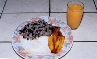 Costa Rican cuisine - A typical Costa Rican breakfast consisting of gallo pinto, fried plantains, an egg, and orange juice