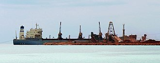 Bauxite - Bauxite being loaded at Cabo Rojo, Dominican Republic, to be shipped elsewhere for processing; 2007