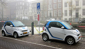 Plug-in electric vehicles in the Netherlands - Two Car2Go Smart electric drives charging at the Herengracht in Amsterdam.