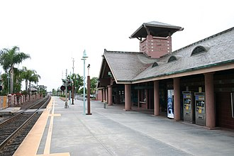 Carlsbad Village station - Platform looking north along the tracks. The pedestrian crossing to the bus bays can be seen on the left.