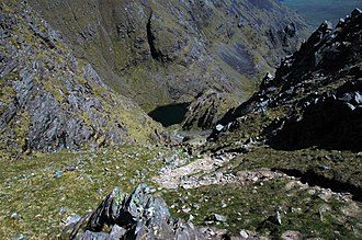 Carrauntoohil - Climbing up Brother O'Shea's Gully with the Eagle's Nest (third level), and Lough Cummeenoughter below.