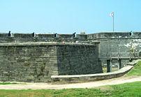 Four cannons overlook the walls of Castillo de...