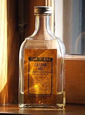 A bottle of castor oil sitting on the window s...