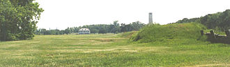 New Orleans metropolitan area - Chalmette Battlefield, with house along the Mississippi River, and battlefield monument.