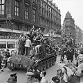 Cheering civilians ride on Cromwell tanks as British troops enter Brussels, 4 September 1944. BU509.jpg