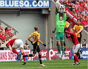 Chris Maxwell (footballer) - Maxwell (centre) catches a cross for Wrexham at Wembley 2013 during the Conference Premier Play-Off Final defeat against Newport County