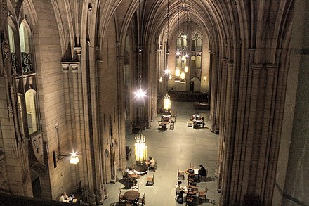The 52 feet (16 m) high, half acre (2,000 m2) Commons Room of the Cathedral of Learning serves as a major study and event space for the university and its students. CoLCommonsRoomUPitt.jpg