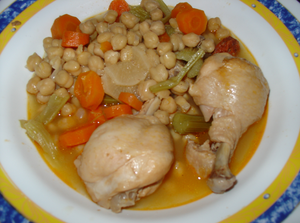 Cocido - Cocido with chickpeas, chicken, celery, carrots, turnips, leeks and chorizo.