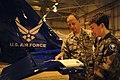 Col. James Clavenna reads the Civil Air Patrol Leadership Manual to son in Joint Base Charleston, South Carolina.jpg
