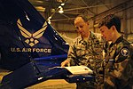 Col. James Clavenna reads the Civil Air Patrol Leadership Manual to son in Joint Base Charleston, South Carolina.jpg