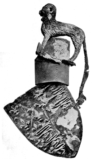 Cap of Maintenance - Shield, helm and crest of Edward, the Black Prince (d. 1376) from his tomb in Canterbury Cathedral. Between the lion crest and the helm is a Cap of Maintenance, now almost entirely decayed