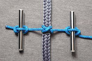 Constrictor knot - A constrictor knot prepared for tightening using two metal rods and marlinespike hitches