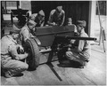 Crew of 37mm. anti-tank gun, in training at Fort Benning, Georgia, clean and adjust their weapon. - NARA - 196275.tif