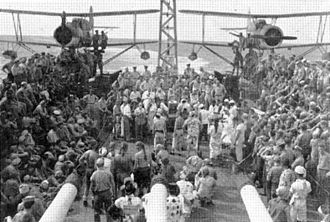USS Montpelier (CL-57) - Curtis SOC-1 Scout-Observation Planes during Line-crossing ceremony on aft of the Montpelier