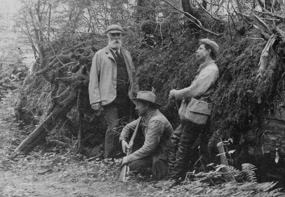 D.G. Elliot, A.K. Fisher, and Robert Ridgway in woods bordering Indian River, Sitka, Alaska, 1899
