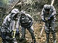 DA-ST-90-10942 West German soldiers wearing nuclear-biological-chemical (NBC) protective suits and masks.jpeg