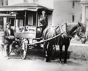 Arabber - David and Harry Silverman in their fruit peddling cart, St. Paul, 1920