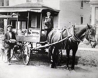 Arabber - David and Harry Silverman in their fruit peddling cart, St. Paul, 1920
