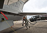 Defense.gov News Photo 111128-F-OC707-900 - Airman Jonathan Quinchia drags the fuel hose to a 46th Test Wing F-16 Fighting Falcon to be refueled at Eglin Air Force Base Fla. on Nov. 28.jpg