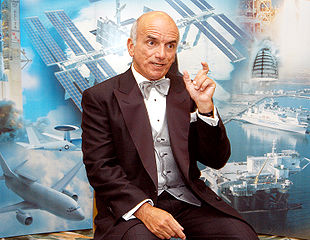 Dennis Tito, the first private citizen to visit the International Space Station, shares his experiences with visitors at the 40th Space Congress<br />NASA photo, from https://en.wikipedia.org/wiki/File:Dennis_Tito.jpg 310px-Dennis_Tito.jpg