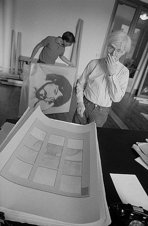 "Thomas Dellert Dellacroix - Andy Warhol looking at an XYZ-production art work ""banana split"" in 1980 in The Factory, photo taken by Bruno Ehrs"