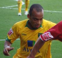 Elliott Omozusi 1.png