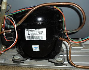 Embraco - A Brazilian-made Embraco compressor fitted in a domestic refrigerator