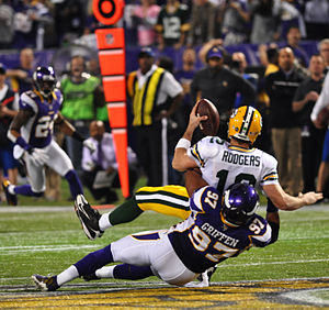 2012 Green Bay Packers season - Image: Everson Griffen Aaron Rodgers sack