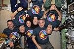Expedition 61 crew gathers inside the Zvezda service module.jpg
