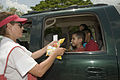 FEMA - 37415 - Red Cross volunteer gives snacks to children in Texas.jpg