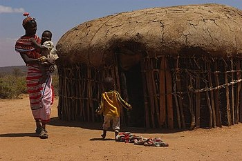 Family outside their hut in Umoja.
