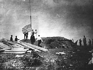 Battle of Guantánamo Bay - 1st Marine Battalion raising the United States flag at Guantánamo Bay on June 10, 1898.