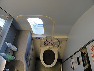 Aircraft lavatory - A Business Class lavatory with a window, on board an Air Canada Boeing 777-200LR (2011)