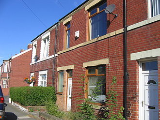 Tyneside flat - Modern conversion of two flats to one house. Note the partially bricked door now forming a window