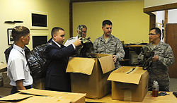 b9755f22ed8 Members of the 89th MacDill Aviation Cadet Squadron sort through boxes of  donated BDUs they received at MacDill AFB.