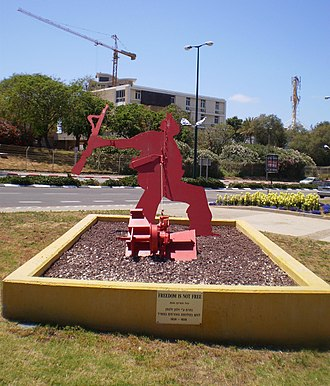 """The Falling Soldier - """"Freedom is not Free"""", a sculpture by Yigal Tumarkin, located in Netanya, Israel."""