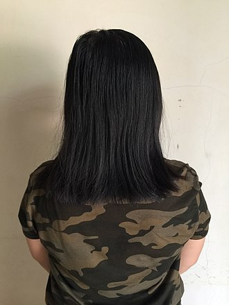 Long hair - A woman with shoulder length hair