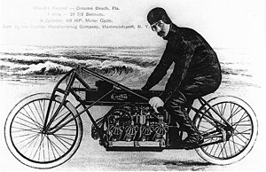 Glenn Curtiss on his V-8 motorcycle, Ormond Beach, Florida 1907.jpg